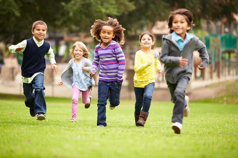 Children running through a park