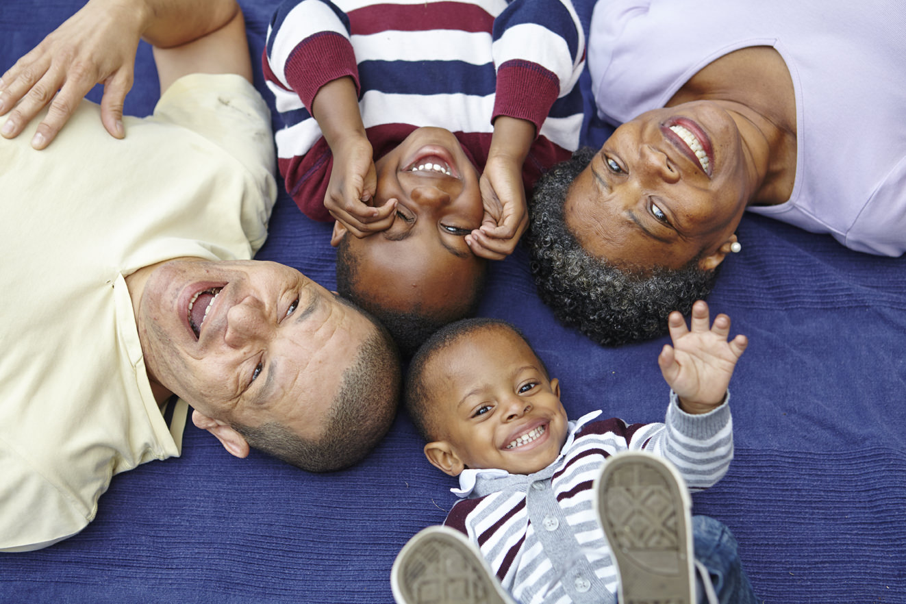 Post-adoption BME family laughing at camera