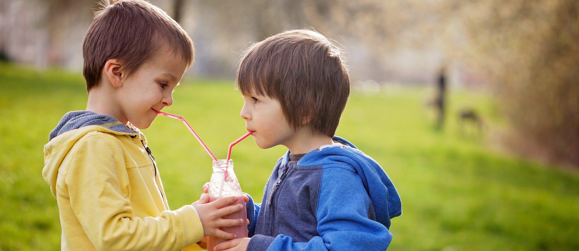 Adopted brothers drinking milkshake