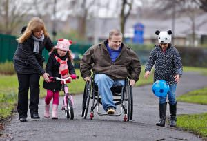 Disabled father with post-adoption family in park