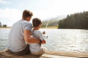 Adopted son fishing with father