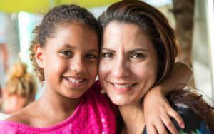 Post-adoption girl with mother