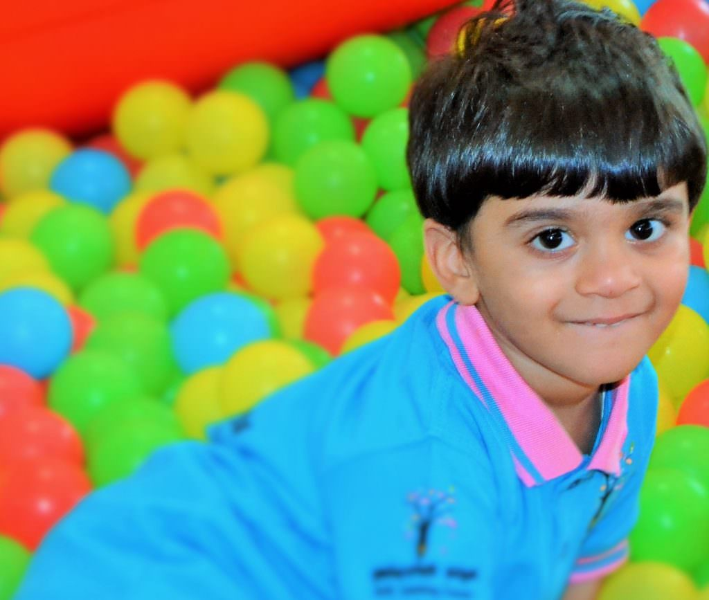 Adopted BME boy playing in a ball pit