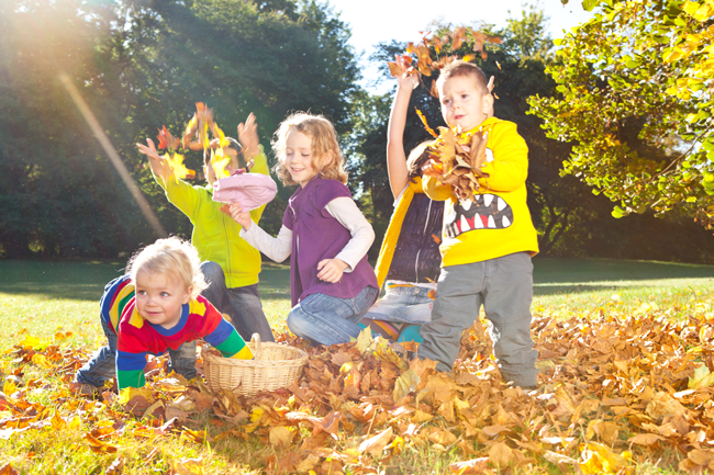 Adopted children playing in the leaves