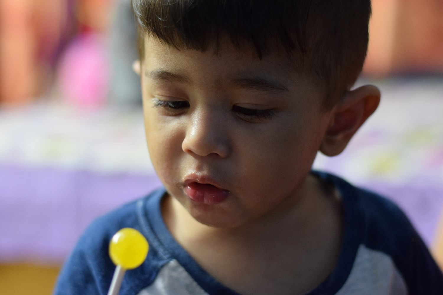Adopted BME boy with a lollipop