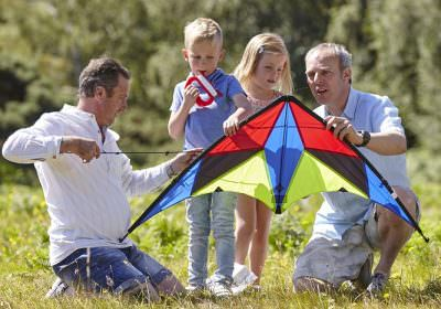 Post-adoption LGBT family with kite
