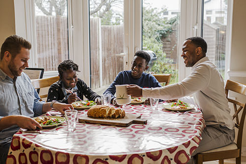 LGBT adoptive family at dinner table