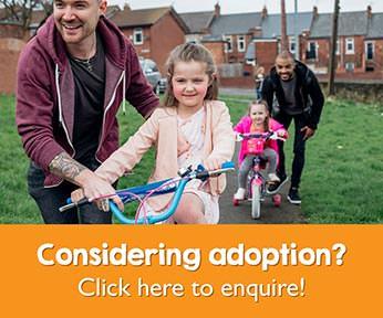 Post-adoption LGBT family with kite